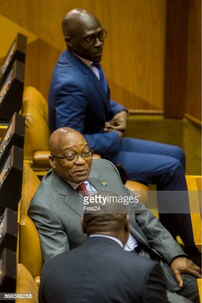 President Jacob Zuma and his deputy Cyril Ramaphosa share a moment during Finance Minister Malusi Gigabas his Mediumterm budget speech in Parliament...