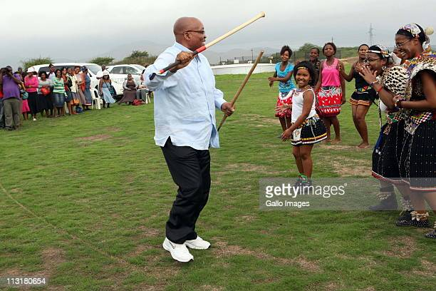President Jacob Zuma attends the joint uMemulo ceremony for his daughters Duduzile and Phumzile at the Zuma homestead in Nkandla on April 21 2011 in...