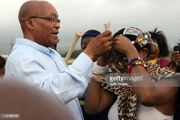President Jacob Zuma attends the joint uMemulo ceremony for his daughters Phumzile and Duduzile at the Zuma homestead in Nkandla on April 21 2011 in...