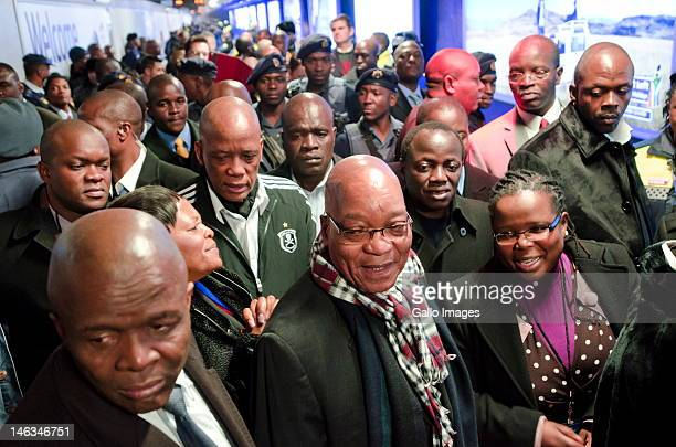 President Jacob Zuma Ben Martins and Collins Chabane ride public transportion during rush hour from the Sandton Gautrain station on June 14 2012 in...