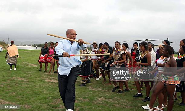 President Jacob Zuma dances during the joint uMemulo ceremony for his daughters Duduzile and Phumzile at the Zuma homestead in Nkandla on April 21...