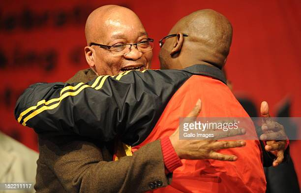 President Jacob Zuma embraces Cosatu President Sdumo Dlamini during Cosatu's 11th National Conference at Gallagher Estate on September 17 2012 in...