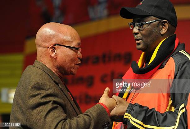 President Jacob Zuma holds hands with Cosatu General Secretary Zwelinzima Vavi during Cosatu's 11th National Conference at Gallagher Estate on...