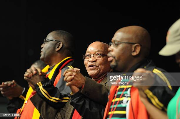 President Jacob Zuma holds hands with Cosatu General Secretary Zwelinzima Vavi and the unions President Sdumo Dlamini during Cosatu's 11th National...