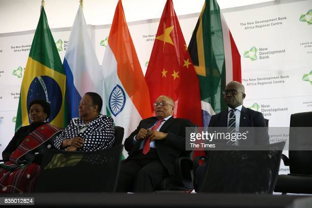 President Jacob Zuma is flanked by Malusi Gigaba Maite NkoanaMashabane and Naledi Pandor during the launch of the bank at the African Regional Centre...
