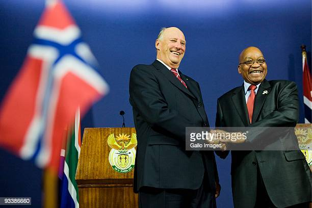 President Jacob Zuma shakes hands with visiting King Harald V of Norway during a welcoming ceremony at the Union Buildings on November 24 2009 in...