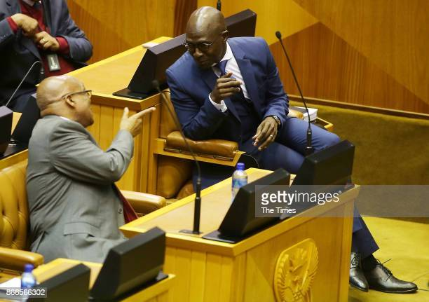 President Jacob Zuma shares a word with finance minister Malusi Gigaba during Gigabas Mediumterm budget speech in Parliament on October 25 2017 in...