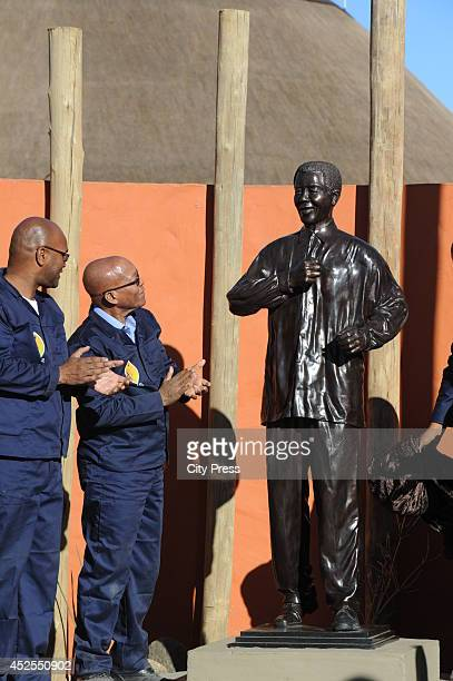 President Jacob Zuma unveils a Nelson Mandela statue at the Mvezo Komkhulu Museum on July 18 2014 in Mvezo South Africa President Zuma spent his 67...