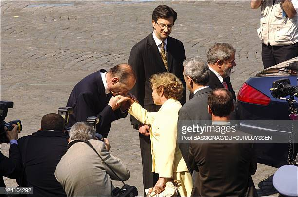 President Jacques Chirac and members of the French government attend French national day ceremonies in the presidential stand on the Champs Elysees...