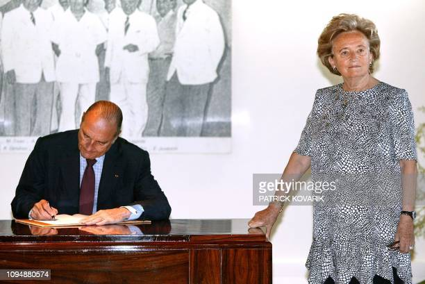 President Jacques Chirac signs the Golden Book of the Assembly of French Polynesia next to his wife Bernadette, July 26, 2003 to the presidency of...