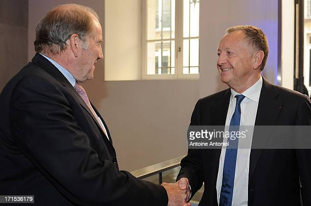 President Jacques Lambert speaks with OL President JeanMichel Aulas during the EURO 2016 Logo Slogan Launch on June 26 2013 in Paris France