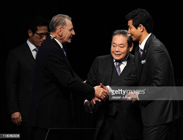 President Jacques Rogge greets IOC member KunHee Lee and Olympic Champion Dae Sung Moon at the end of the PyeongChang 2018 bid presentacion during...