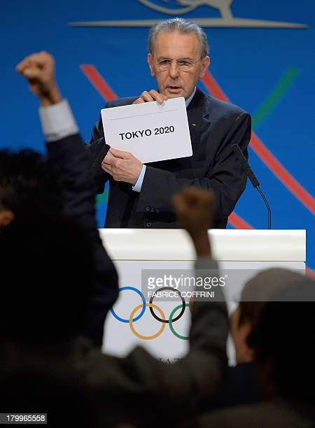 IOC President Jacques Rogge shows the card reading 'Tokyo' as he announces the winner of the bid to host the 2020 Summer Olympic Games during the...