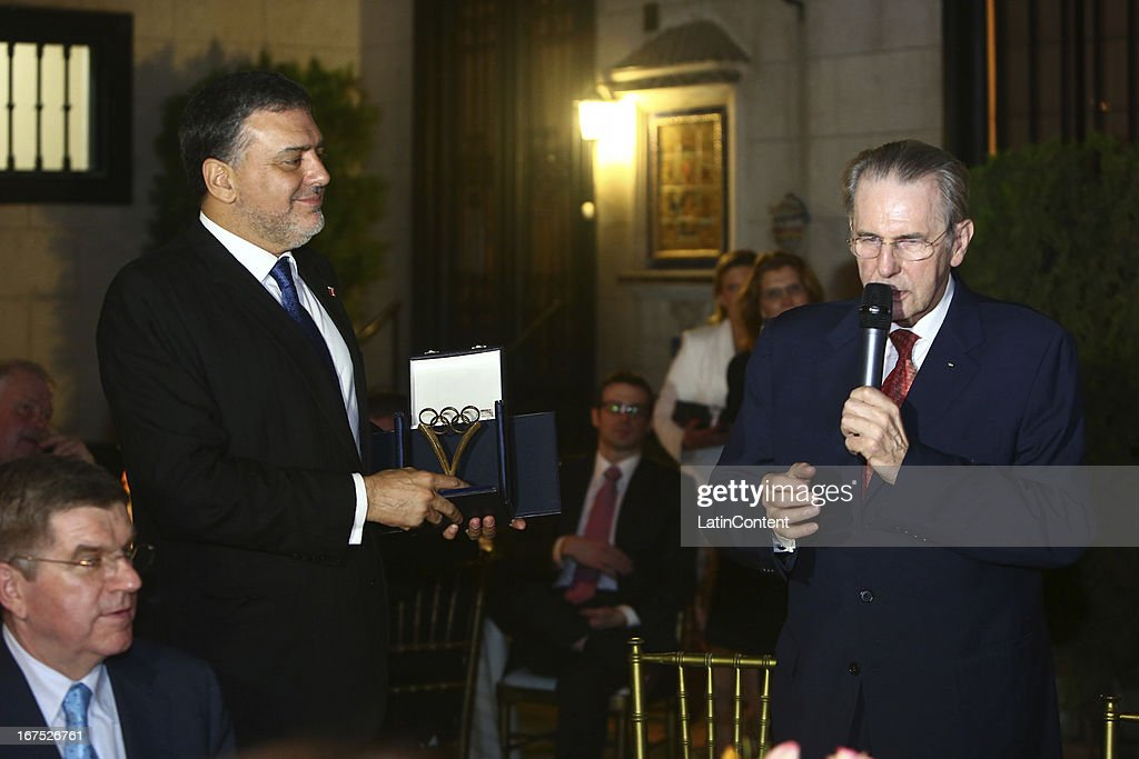 President Jacques Rogge speaks to the guests as Jose Quiñones, Peruvian Olympic Committe holds a present, during the gala dinner on the second day of the 15th IOC World Conference Sports For All at Casa García Alvarado on April 25, 2013 in Lima, Peru.