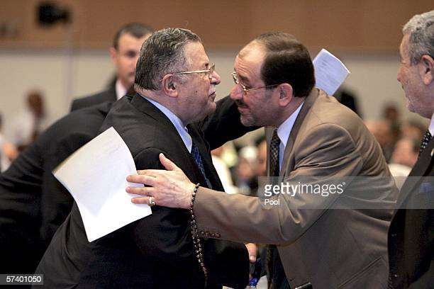President Jalal Talabani congratulates new Iraqi Prime Minister Jawad alMaliki during the second session of the parliament on April 22 2006 in...