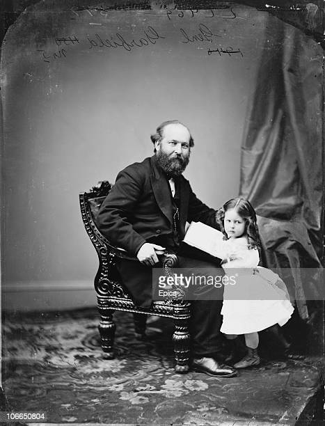President James Garfield the twentieth president of the United States poses with one of his daughters circa 1870