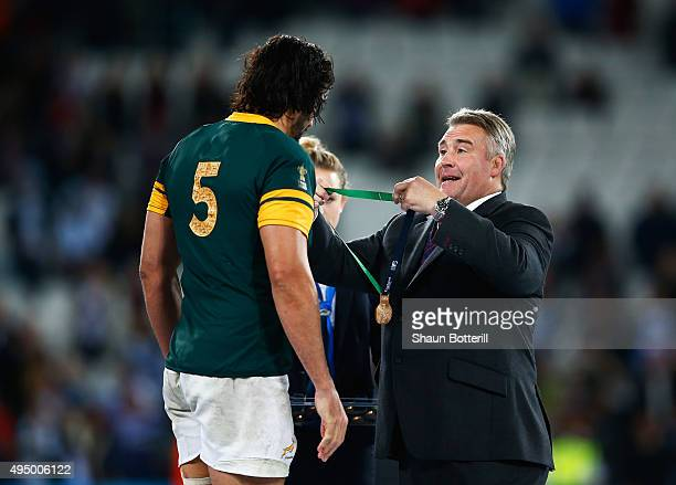 RFU president Jason Leonard presents Victor Matfield of South Africa with his bronze medal after the 2015 Rugby World Cup Bronze Final match between...