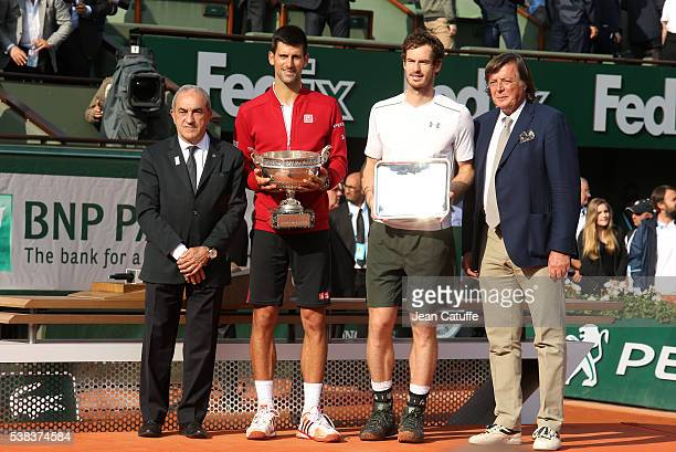 President Jean Gachassin winner Novak Djokovic of Serbia finalist Andy Murray of Great Britain Adriano Panatta pose during the the trophy ceremony...