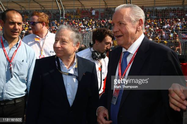 President Jean Todt and 1980 F1 World Drivers Champion Alan Jones talk on the grid before the F1 Grand Prix of Australia at Melbourne Grand Prix...