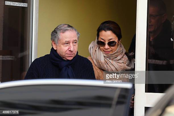 FIA president Jean Todt and his wife actress Michelle Yeoh leave the Grenoble University Hospital Centre where former German Formula One driver...