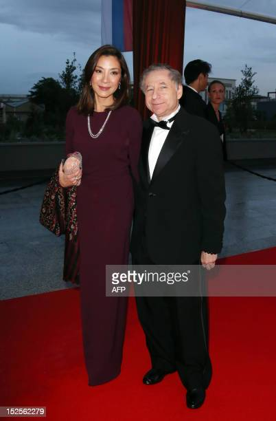 FIA President Jean Todt and his wife MalaysianChinese actress Michelle Yeoh pose as they arrive to attend the inauguration ceremony of the Cite du...