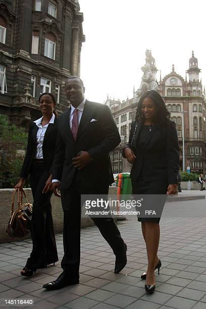 President Jeffrey Webb arrives with his wife and daughter at the Fortuna Castle Restaurant for the CONCACAF dinner on May 23 2012 in Budapest Hungary