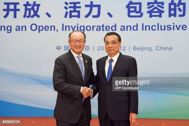 President Jim Yong Kim of the World Bank shakes hands with Chinese Premier Li Keqiang before The 1+6 Round Table Dialogue meeting at the Diaoyutai...
