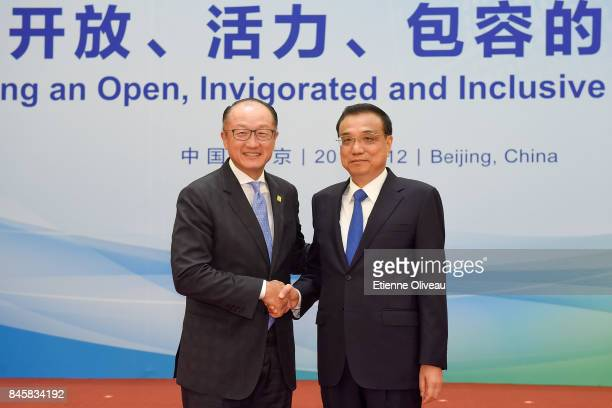 President Jim Yong Kim of the World Bank shakes hands with Chinese Premier Li Keqiang before The 1+6 Round Table Dialogue meeting at Diaoyutai State...