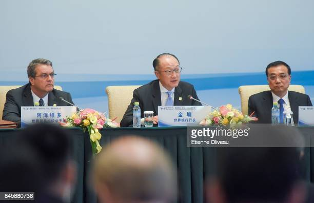 President Jim Yong Kim of the World Bank speaks as he seats between Chinese Premier Li Keqiang and DirectorGeneral Roberto Azevedo of the World Trade...