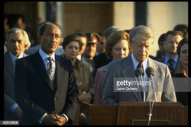 US President Jimmly Carter and wife Roslyn being greeted by Egyptian President Anwar Sadat and Prime Minister Mustafa Khalil at airport upon their...