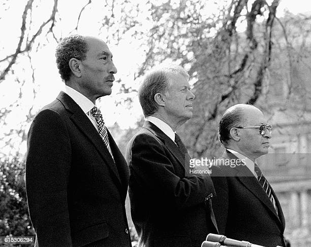 President Jimmy Carter acts as a witness to the signing of the Camp David accords, a peace treaty between Israel and Egypt which was signed by...