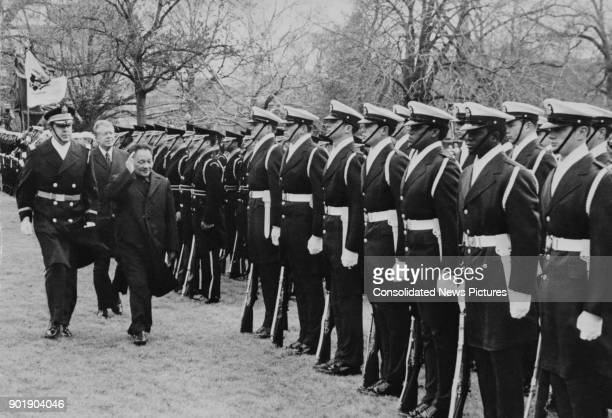 US President Jimmy Carter and Deng Xiaoping inspect a guard of honour on the South Lawn of the White House in Washington DC after the Chinese Vice...