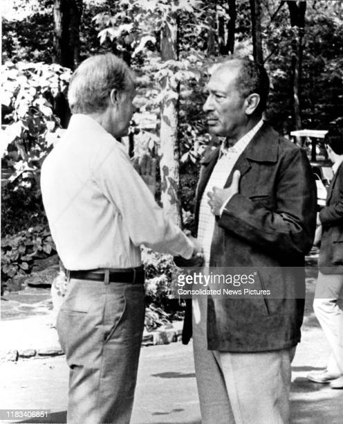 US President Jimmy Carter and Egyptian President Anwar Al Sadat shake hands during the EgyptianIsraeli peace negotiations at Camp David near Thurmont...