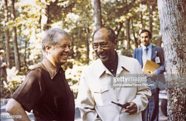 US President Jimmy Carter and Egyptian President Anwar Al Sadat talk together during the EgyptianIsraeli peace negotiations at Camp David near...