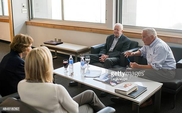 President Jimmy Carter and Former First Lady Rosalynn Carter speak with Aspen Institute president and CEO Walter Isaacson and Cathy Isaacson during...