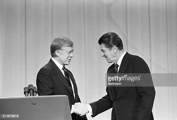 President Jimmy Carter and his Republican challenger Ronald Reagan shake hands as they greet one another before their debate on the stage of the...