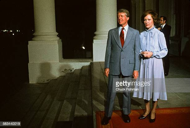 President Jimmy Carter and his wife First Lady Rosalynn Carter at the entrance to the White House awaiting a guest, Washington, DC, March 22, 1978....