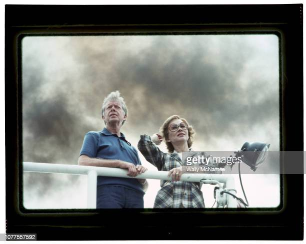 President Jimmy Carter and his wife Rosalynn look out from the deck of the Delta Queen riverboat The couple vacationed by sailing down the...