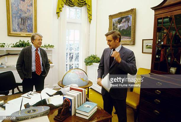 """President Jimmy Carter and Vice President Walter """"Fritz"""" Mondale talk at the White House in May 1977 in Washington, D.C."""