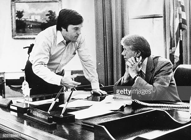 President Jimmy Carter at his desk in the Oval Office talking to his new Chief of Staff Hamilton Jordan White House Washington D C July 19th 1979