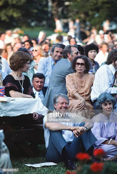 President Jimmy Carter center seated on the South Lawn of the White House during the White House Jazz Concert on the occasion of the 25th anniversary...