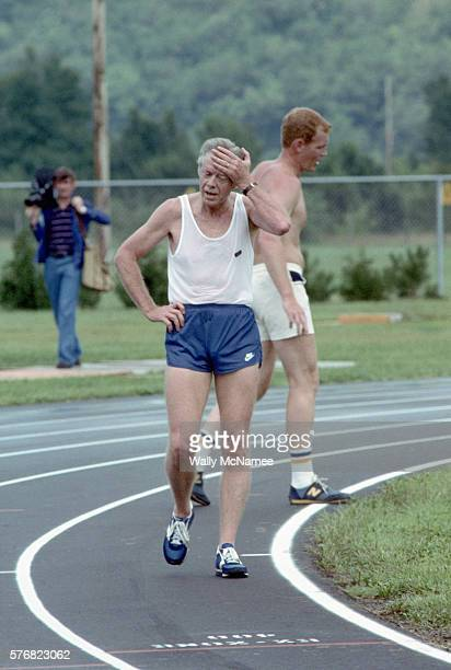 President Jimmy Carter cools down after a jog while he waits for the Delta Queen clear the docks Carter had been vacationing by sailing down the...