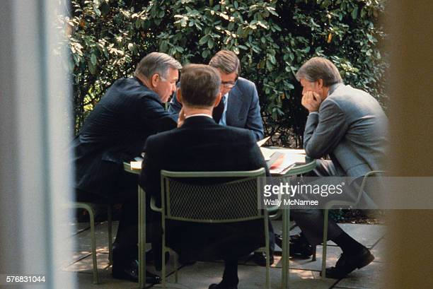 President Jimmy Carter goes over map of Israel and discusses border problems with CIA Director Stansfield Turner Defense Secretary Harold Brown and...