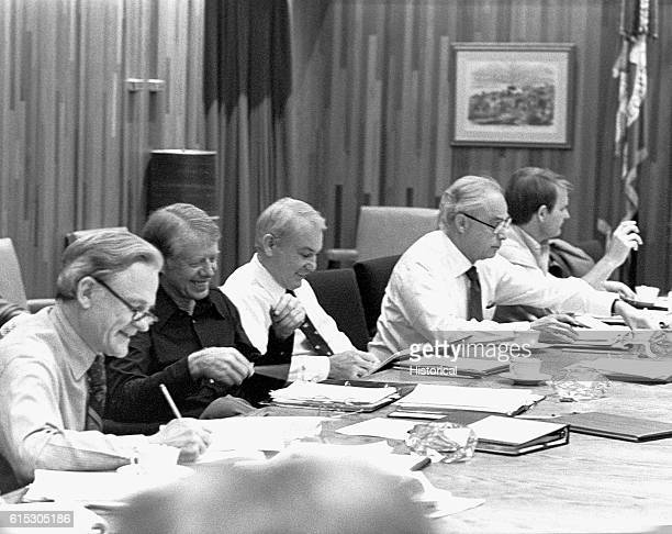 President Jimmy Carter holds a meeting of his cabinet officers at Camp David to discuss the issues of energy and inflation Maryland USA March 19 1979