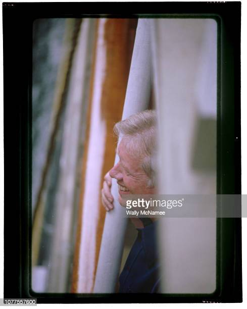 President Jimmy Carter holds onto the railing and looks out from the deck of the Delta Queen riverboat Carter and his wife vacationed by sailing down...