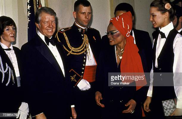 President Jimmy Carter in reception line about to greet singer / actress Eartha Kitt who is followed by her daughter Kitt McDonald on the occasion of...