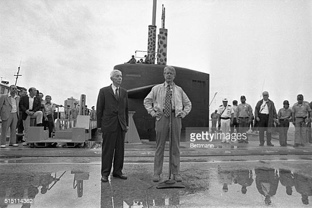 President Jimmy Carter is shown with Admiral Hyman Rickover after completing an Atlantic cruise aboard the submarine USS Los Angeles