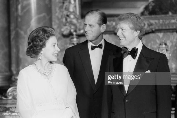 President Jimmy Carter joins Queen Elizabeth II and the Duke of Edinburgh at Buckingham Palace when he and six other world leaders attended dinner in...