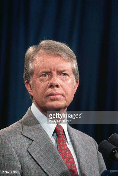 President Jimmy Carter listens to a question during a press conference at the Old Executive Office Building