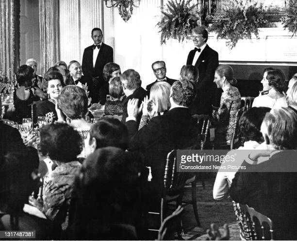 President Jimmy Carter offers a toast to the Shah of Iran Mohammed Reza Pahlavi during a State Dinner in the latter's honor in the State Dining Room...
